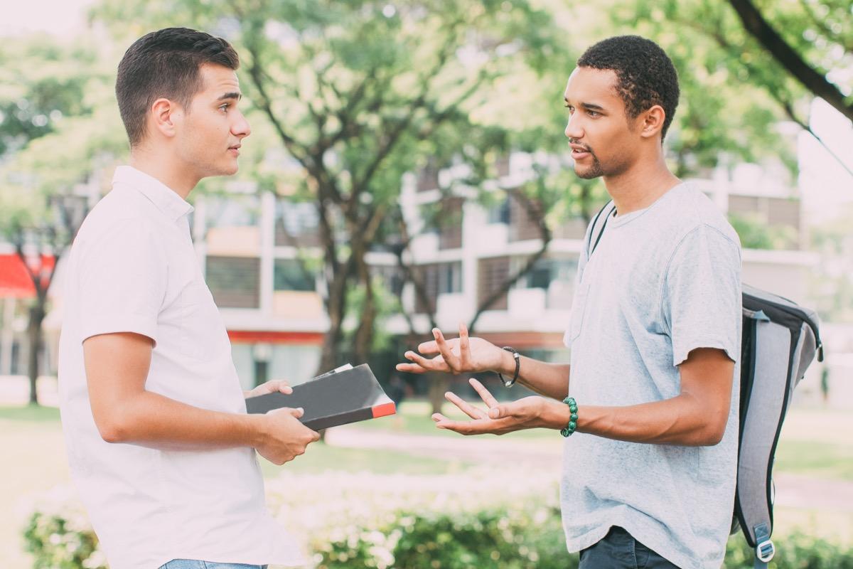 friends talking on a college campus, rude behavior