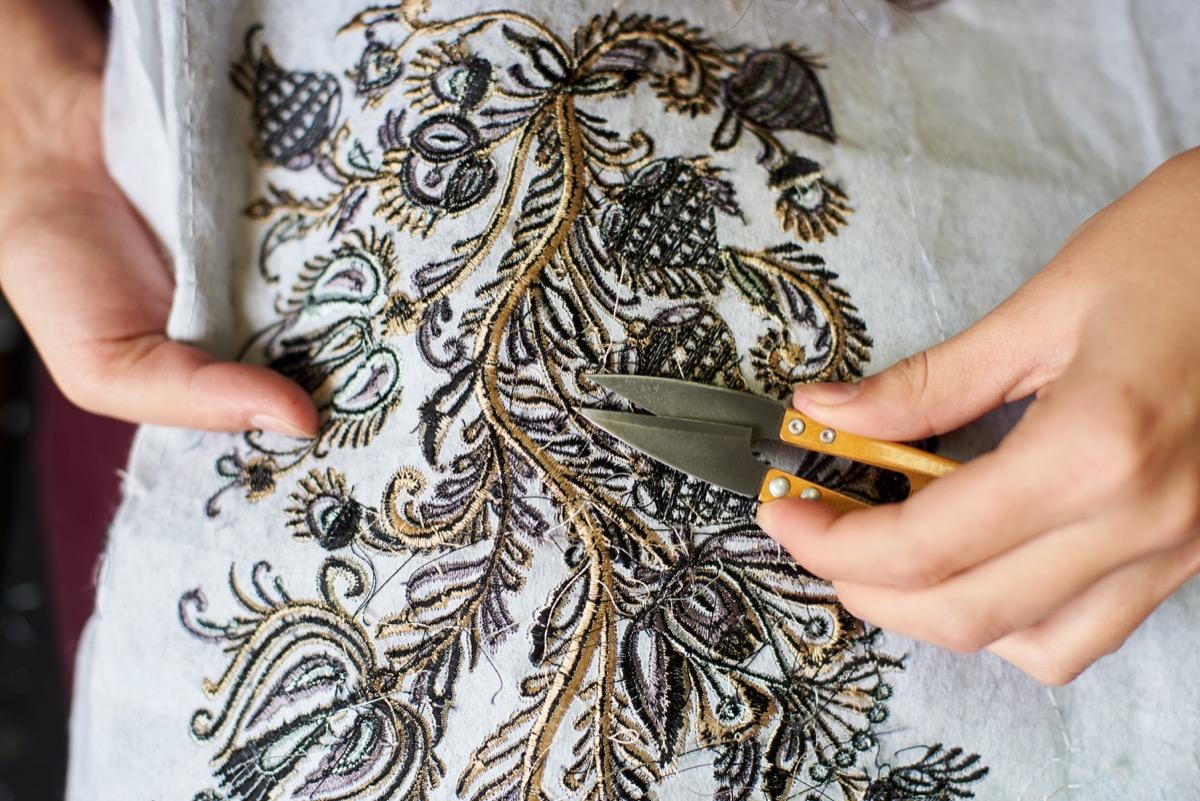 Woman Fixing Garment Ways You Ruin Clothing
