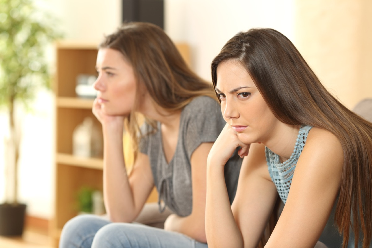 teen girls arguing and looking upset on couch, skills parents should teach kids