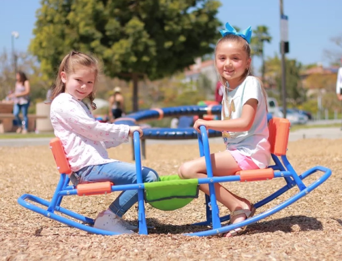 two children sitting in blue seesaw, best outdoor toys for toddlers