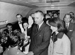 Lyndon B. Johnson getting sworn in next to Jackie Kennedy Jackie Kennedy Pink Chanel Suit