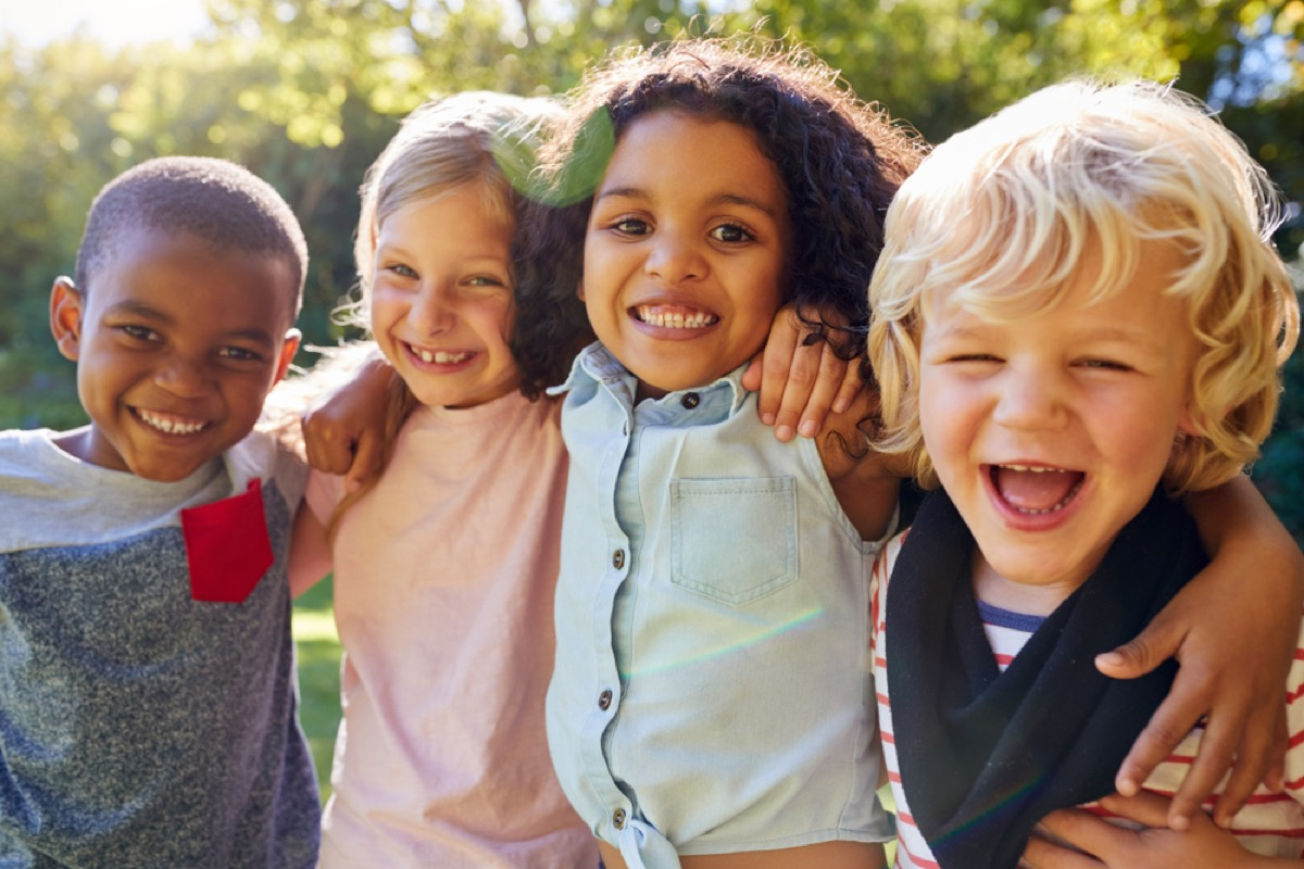 kids laughing outdoors, skills parents should teach kids