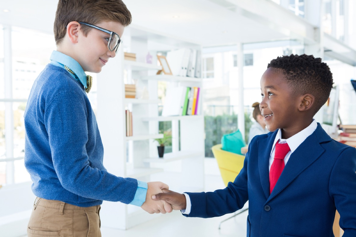 two young boys shaking hands, skills parents should teach kids