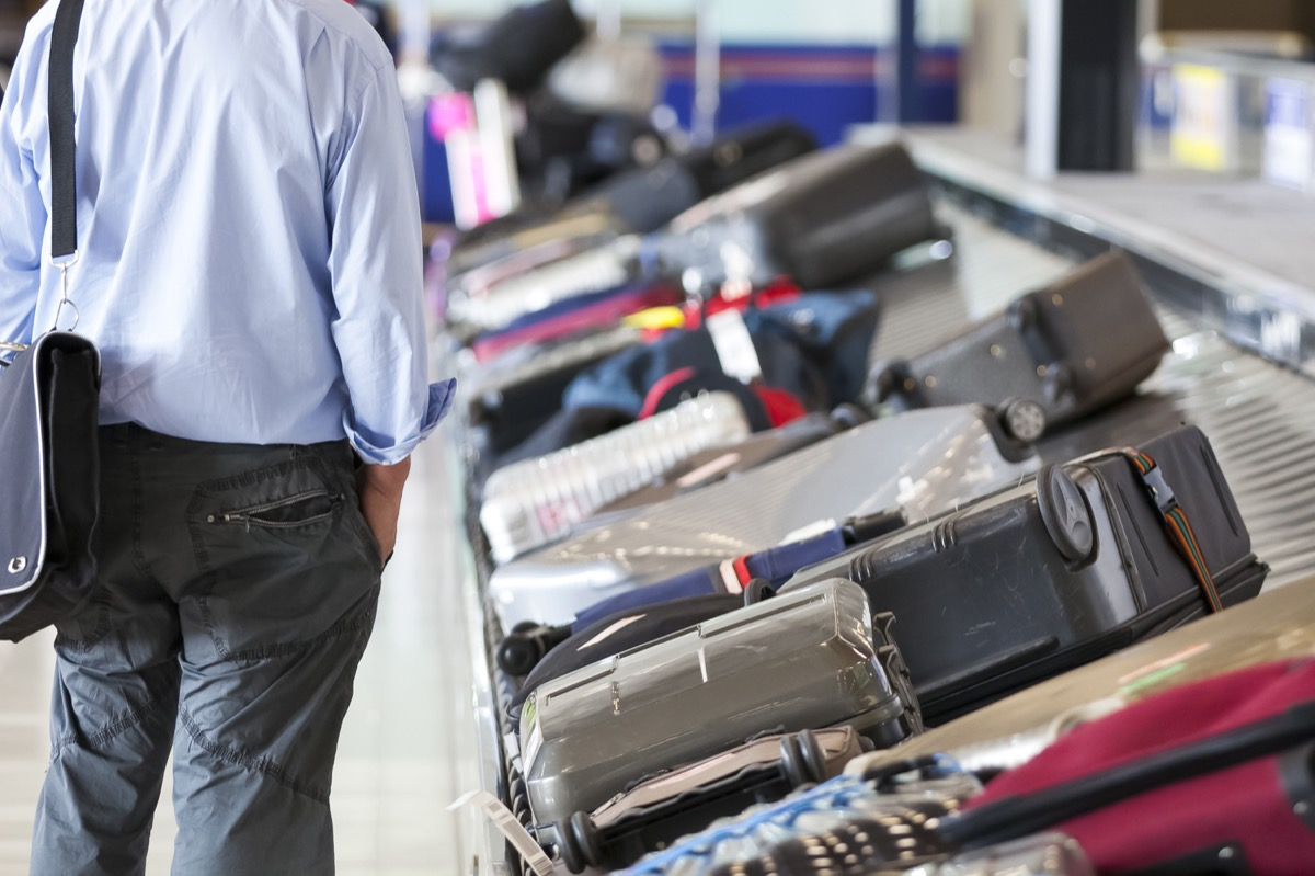 man at baggage claim