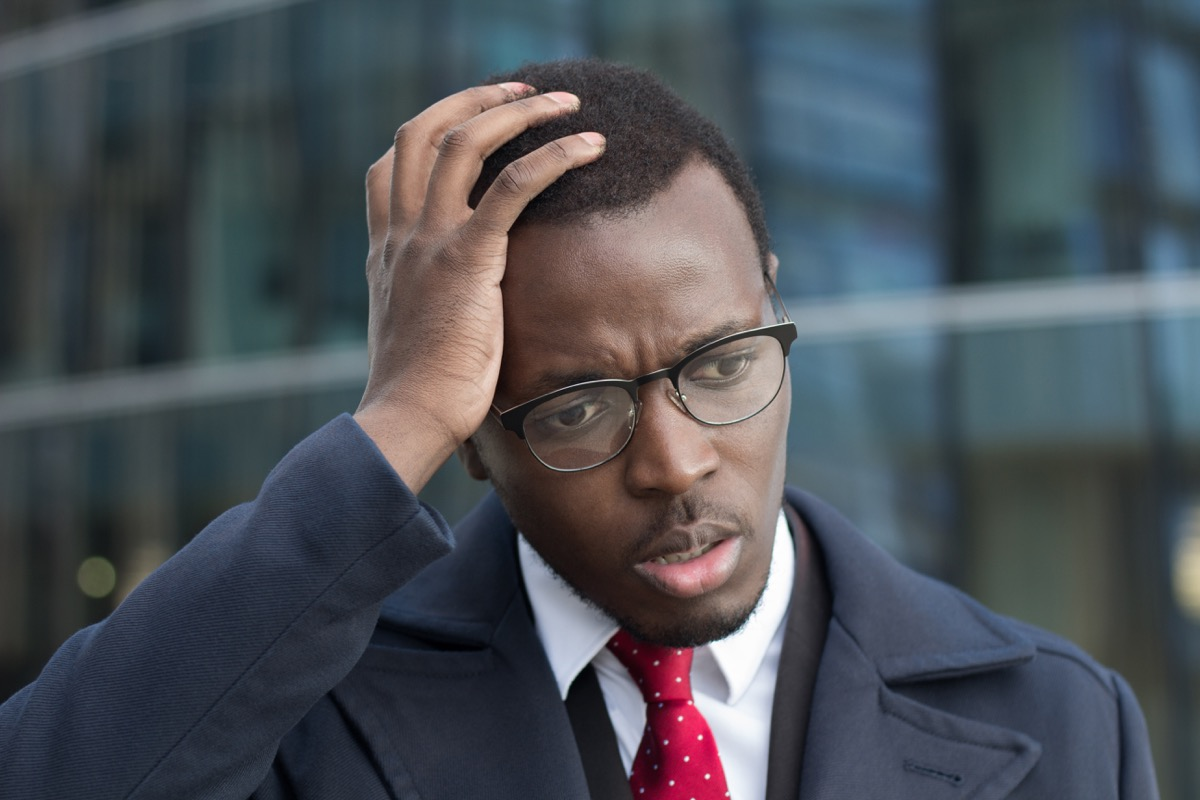 Man scratching his head confused