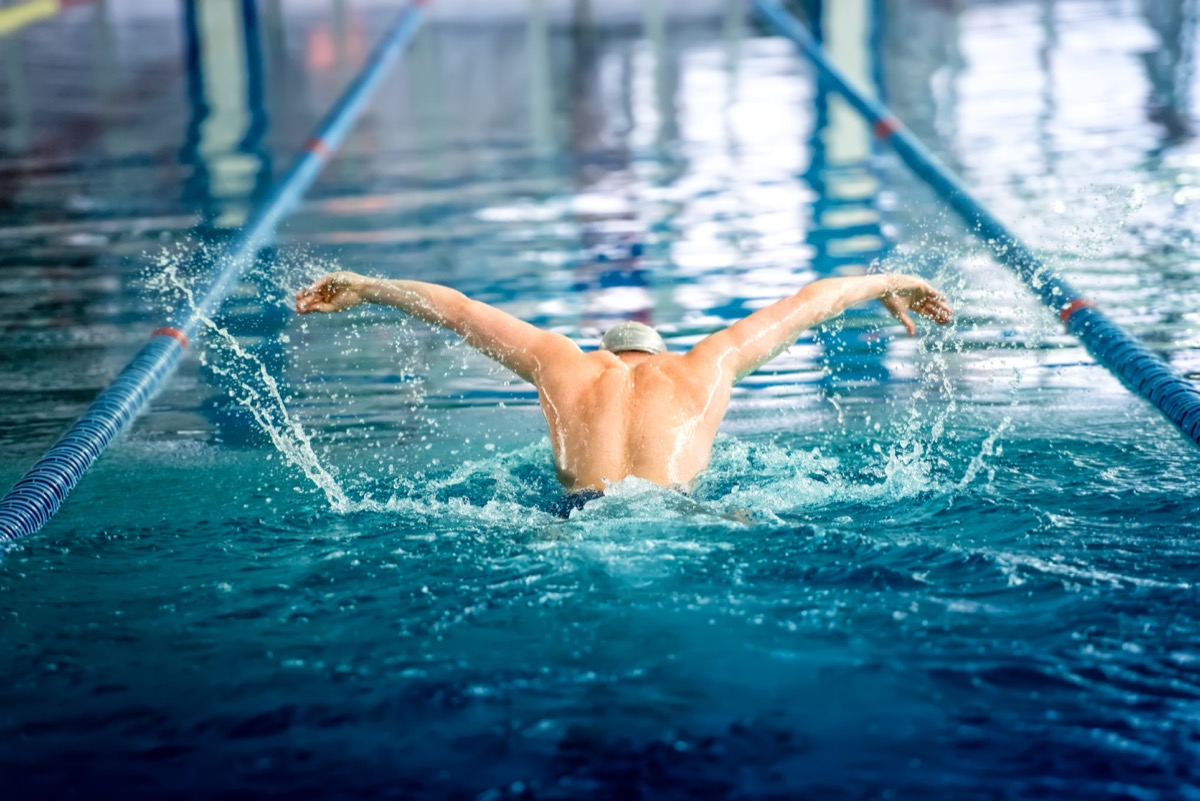 a man swimming in a lap pool