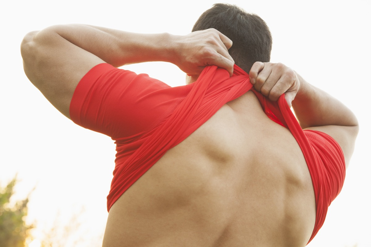 man taking off his shirt to turn inside out, weird state records