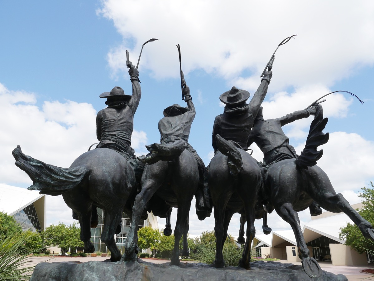 statue of cowboys on their horses