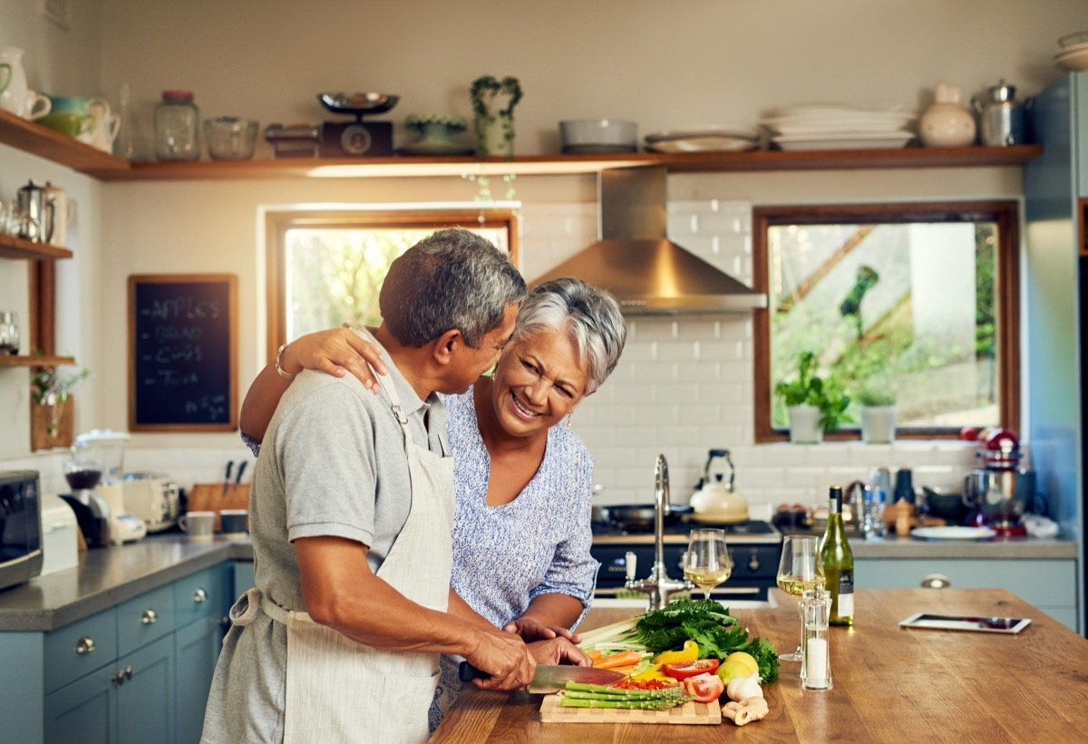 old couple cooking dinner together