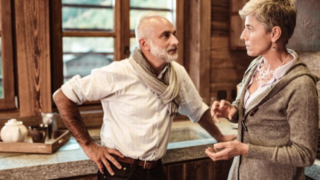 older couple fighting with each other in kitchen