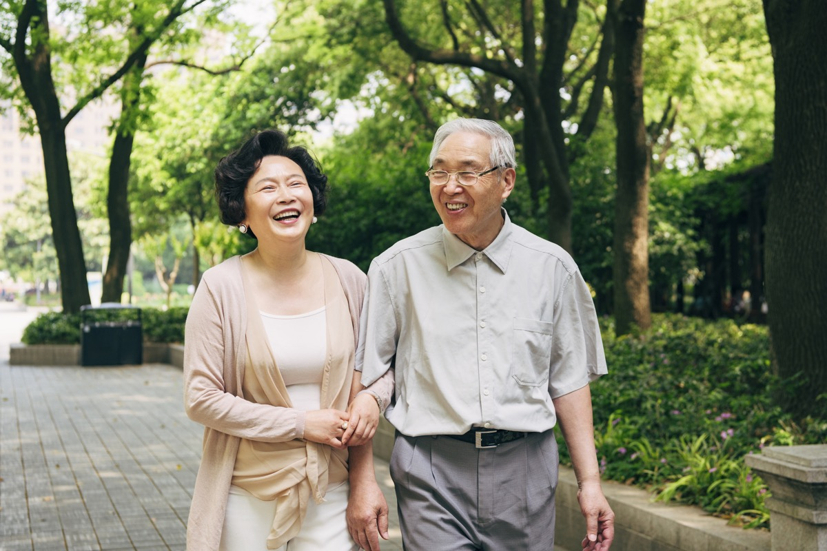 old couple walking a trail together