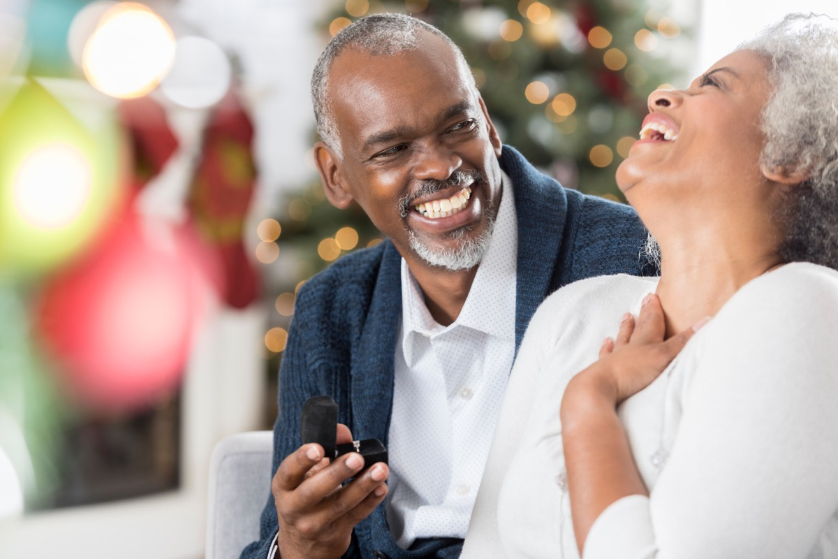 old man giving gift to his wife