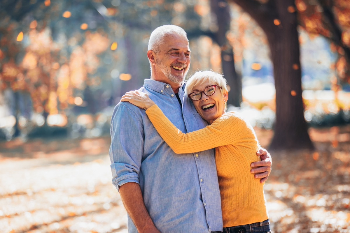 older couple laughing and walking together