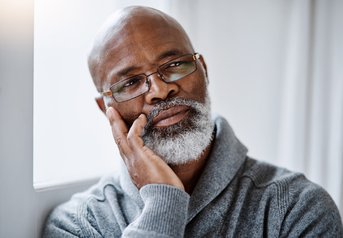 older man staring and thinking off into space
