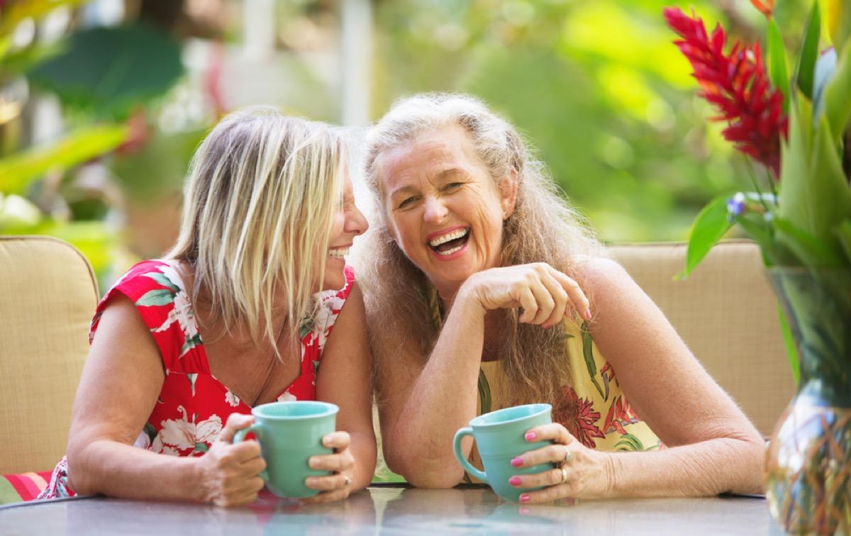 two older women laughing outside, female friend
