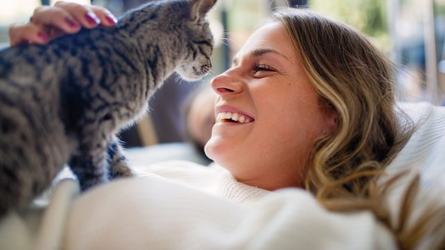 owner laughing with her cat