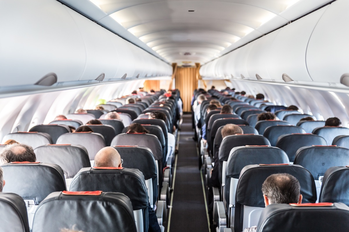 people in a crowded airplane cabin