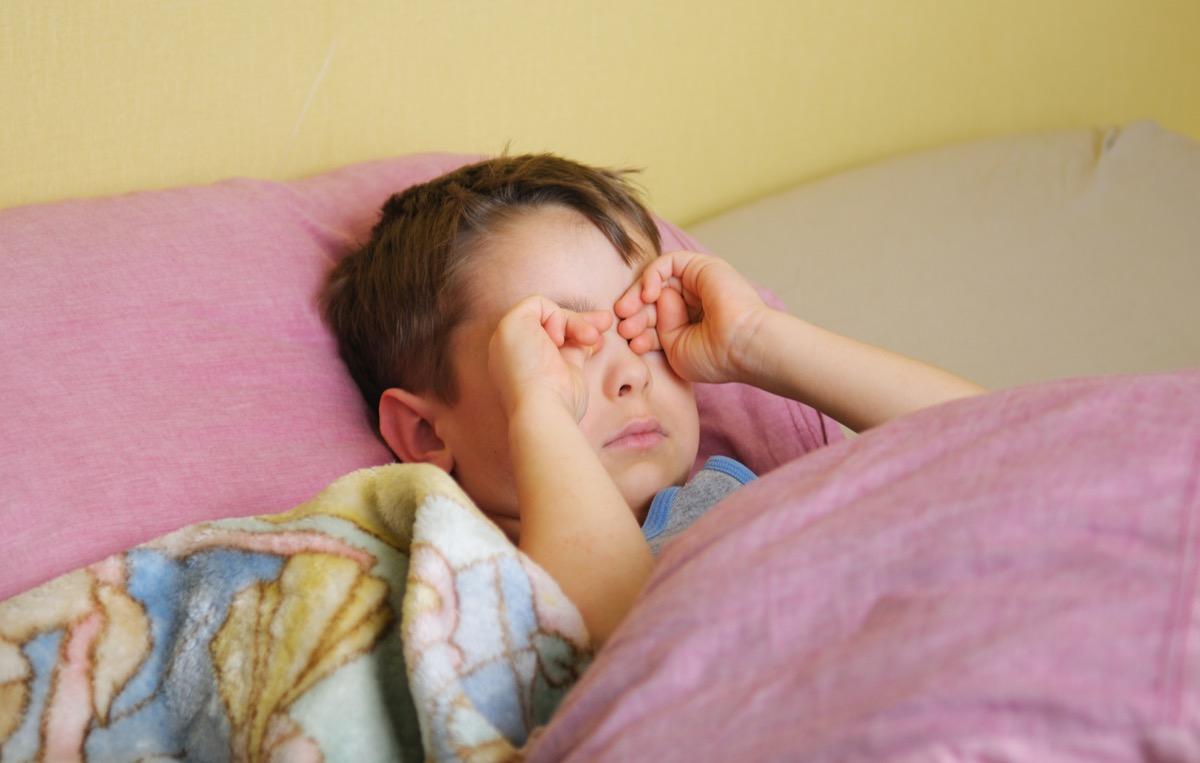 pink eye with kid rubbing eyes