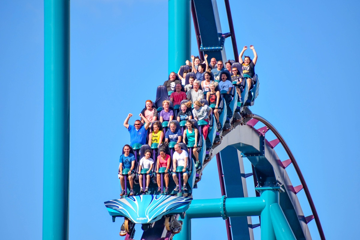 People on a roller coaster ride in Orlando Florida at disney world