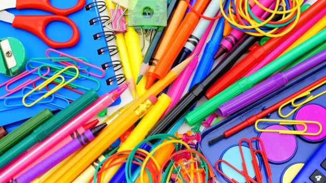 school supplies pile paper clips scissors pencils markers