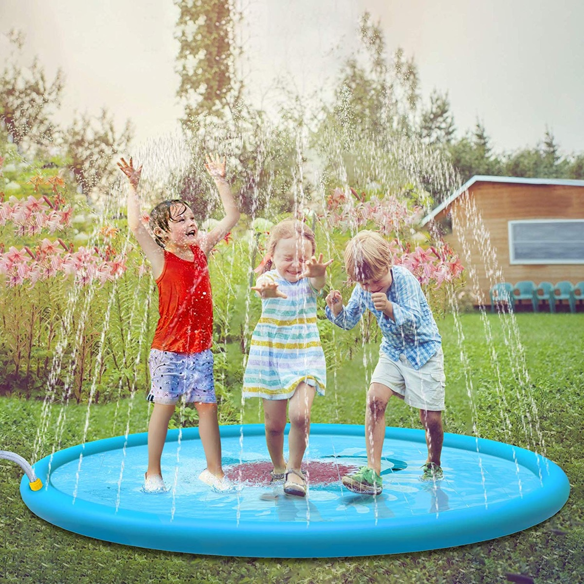 three children playing on sprinkler, best outdoor toys for toddlers