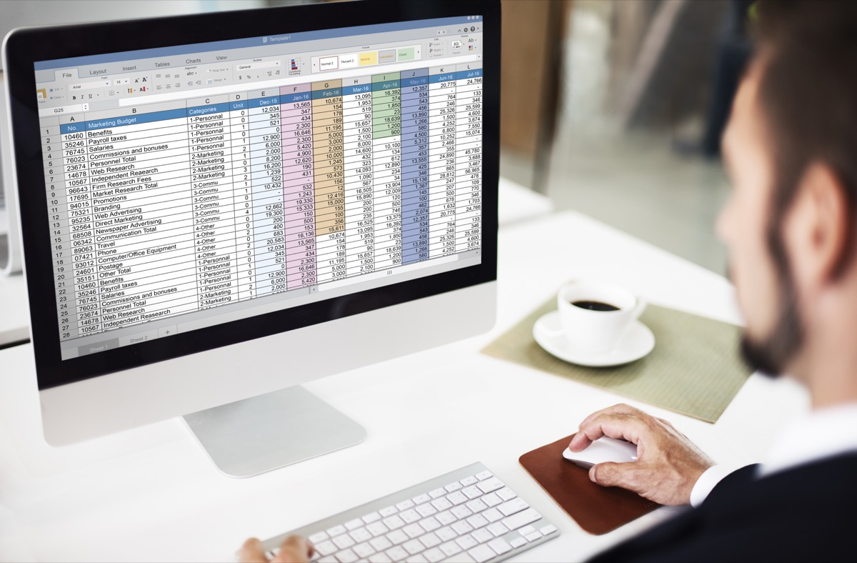 man working on a spreadsheet