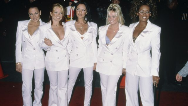 the spice girls wearing white double-breasted suits
