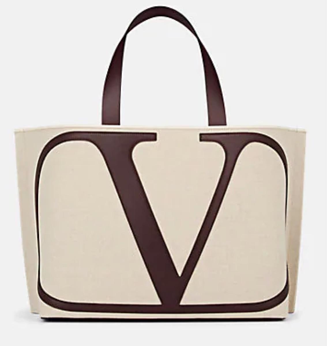 white tote with big V logo, luxury beach bags