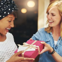 woman giving her friend a gift, best friend gifts
