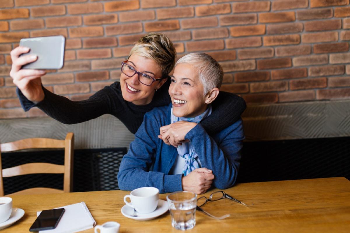 older women taking selfie, female friend