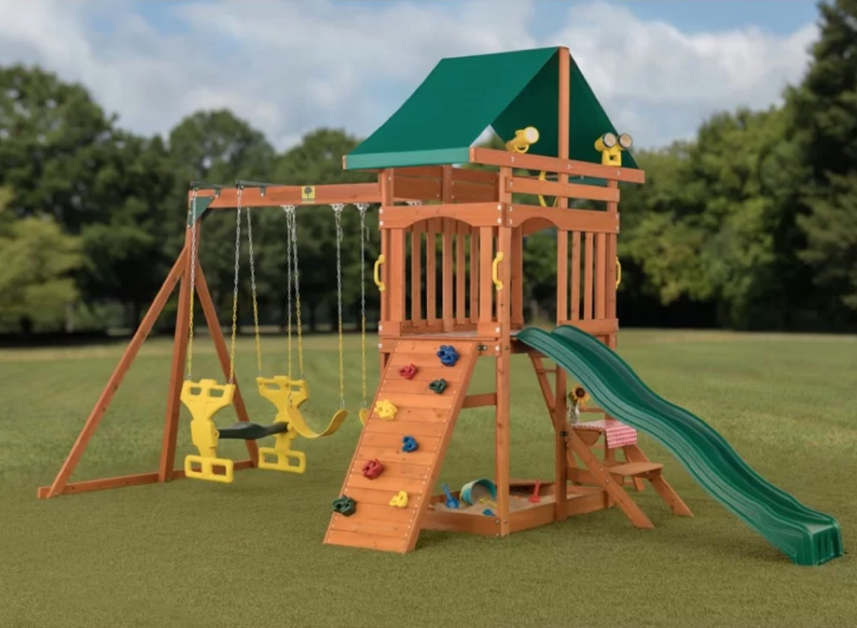wooden swing set with climbing wall and slide, best outdoor toys for toddlers