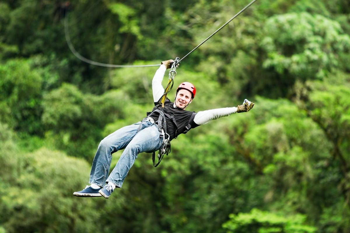 man on a zipline in the daytime