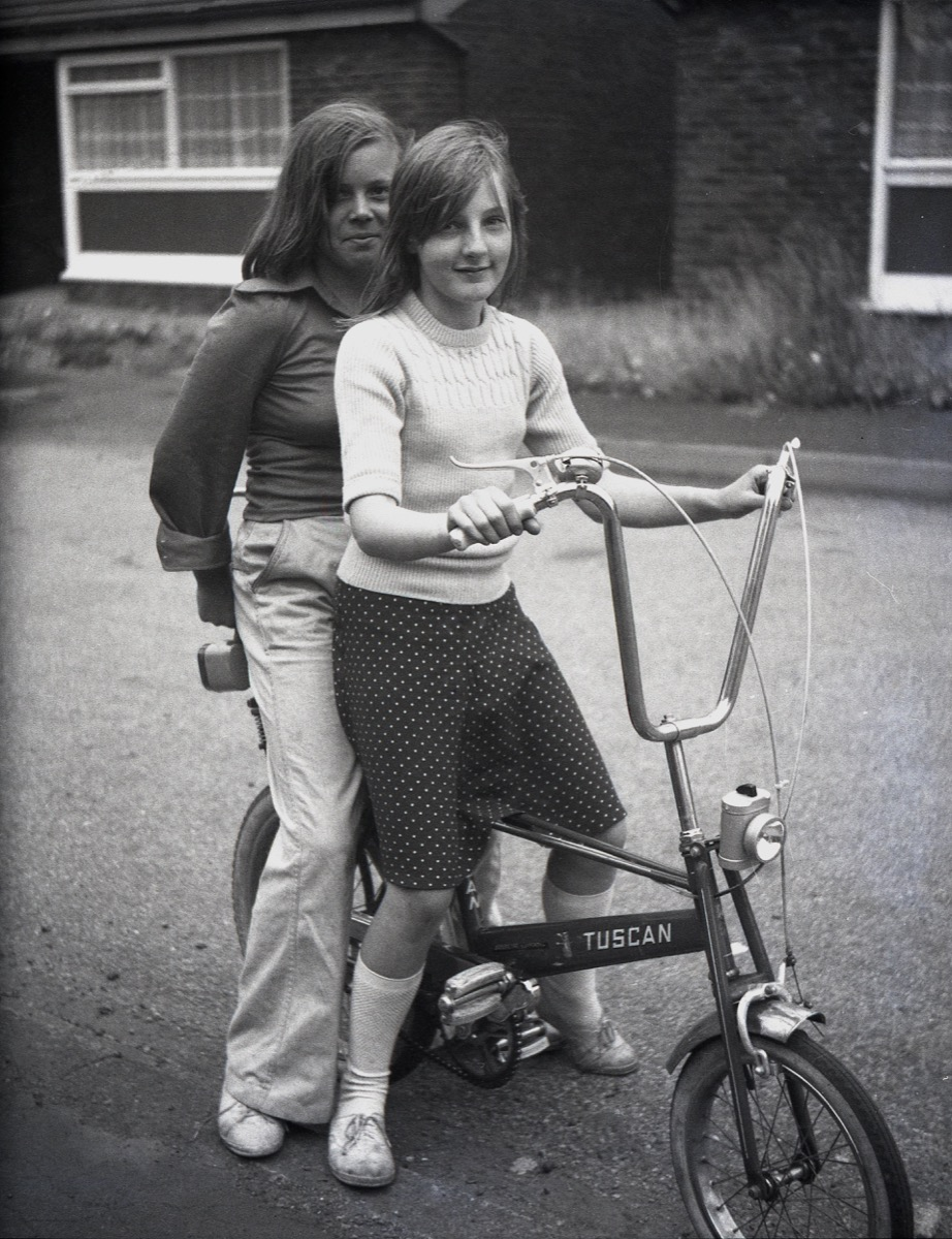 2 girls riding a bike with no helmets, 70s