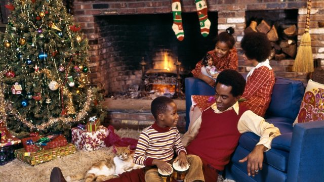 1970s Black Family in Living Room with Shag Carpet at Christmas