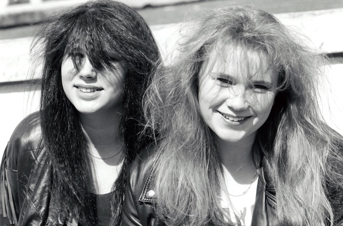 Teenage girls with big hair in 1980s