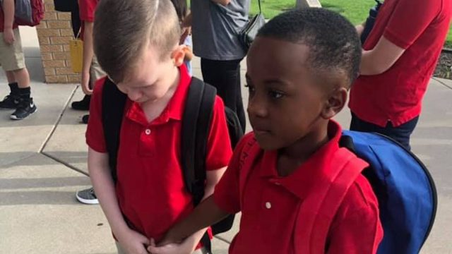 viral photo of boy comforting classmate with autism