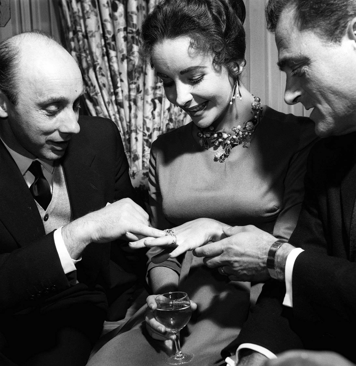 Elizabeth Taylor with Husband Mike Todd showing off diamond ring to Donald Zec April 1957
