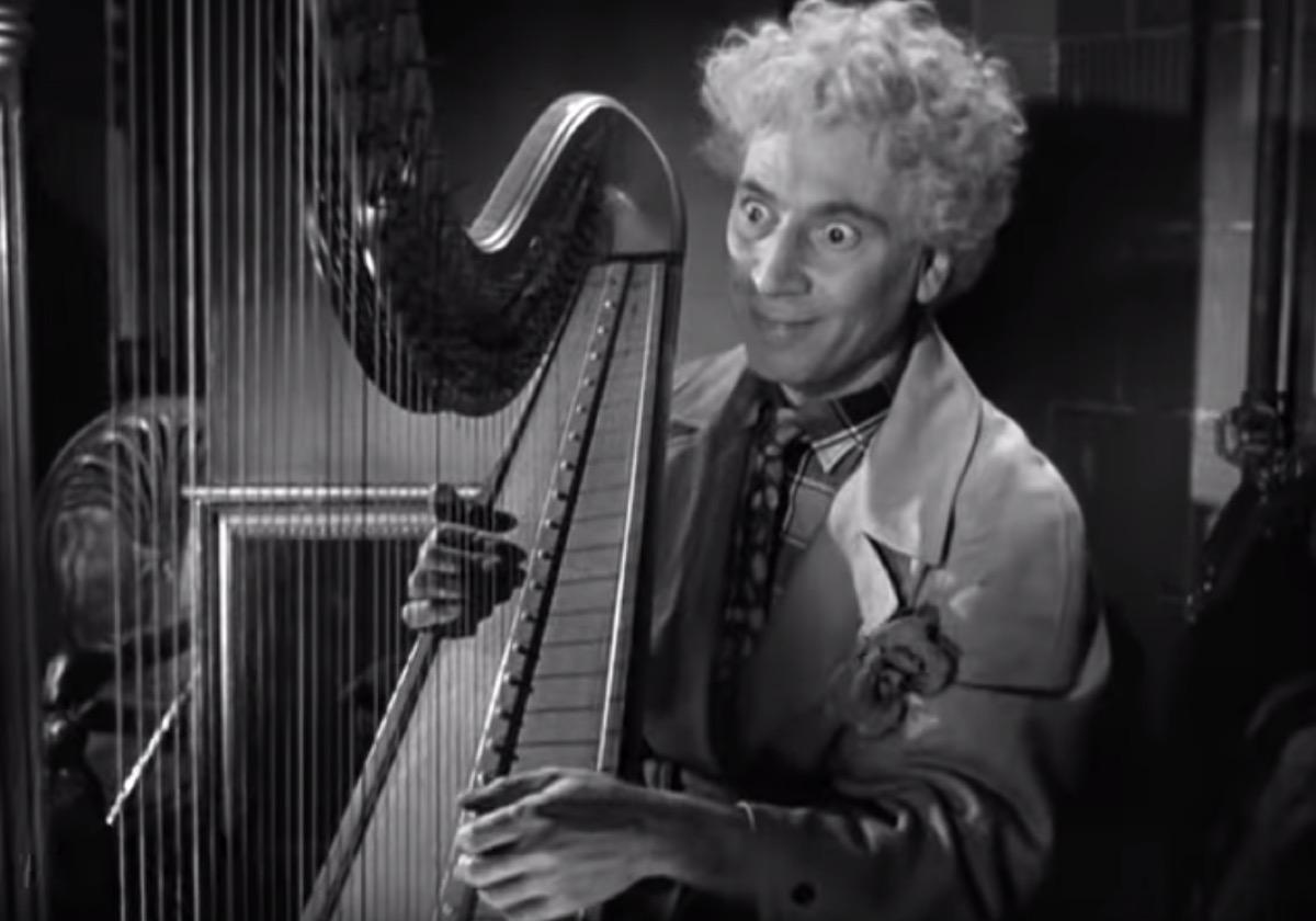 Harpo Marx playing the harp