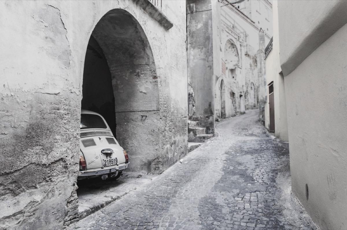 White fiat in alleyway