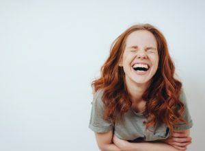 Young red-haired woman laughing