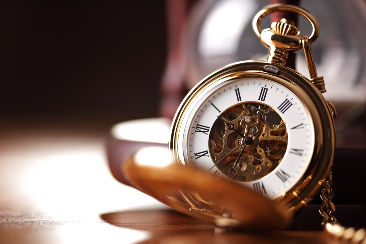 an old pocket watch propped open, titanic artifacts