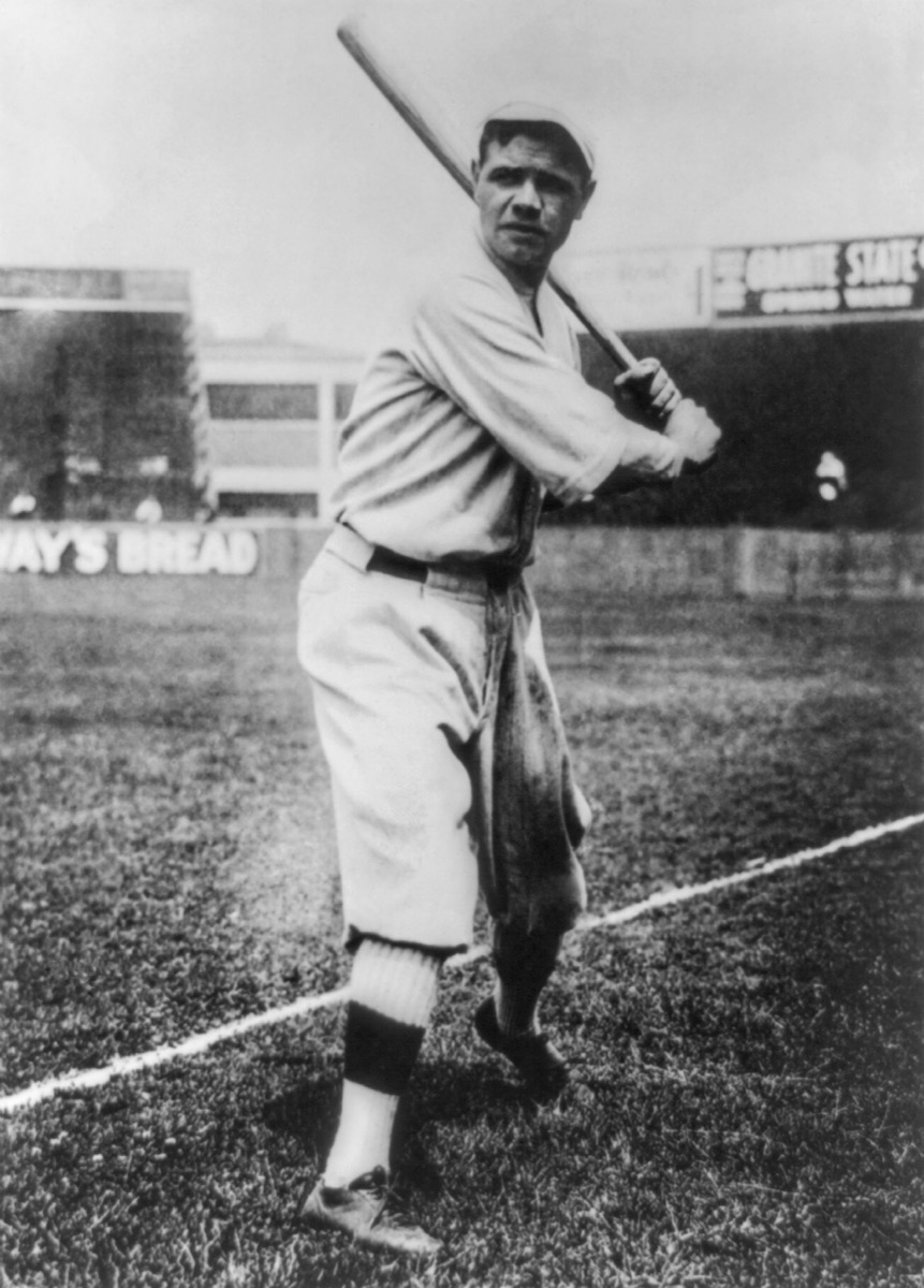 Babe Ruth poses with a bat