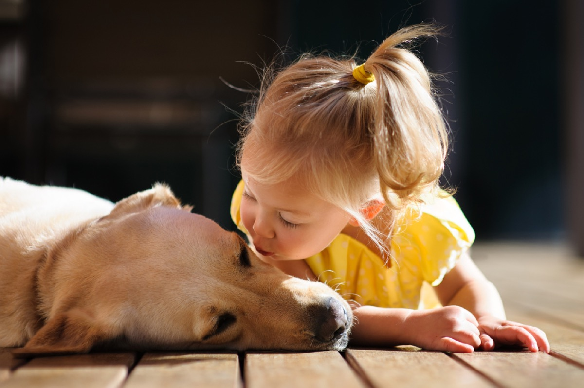 little girl playing with dog, things you should never lie to kids about