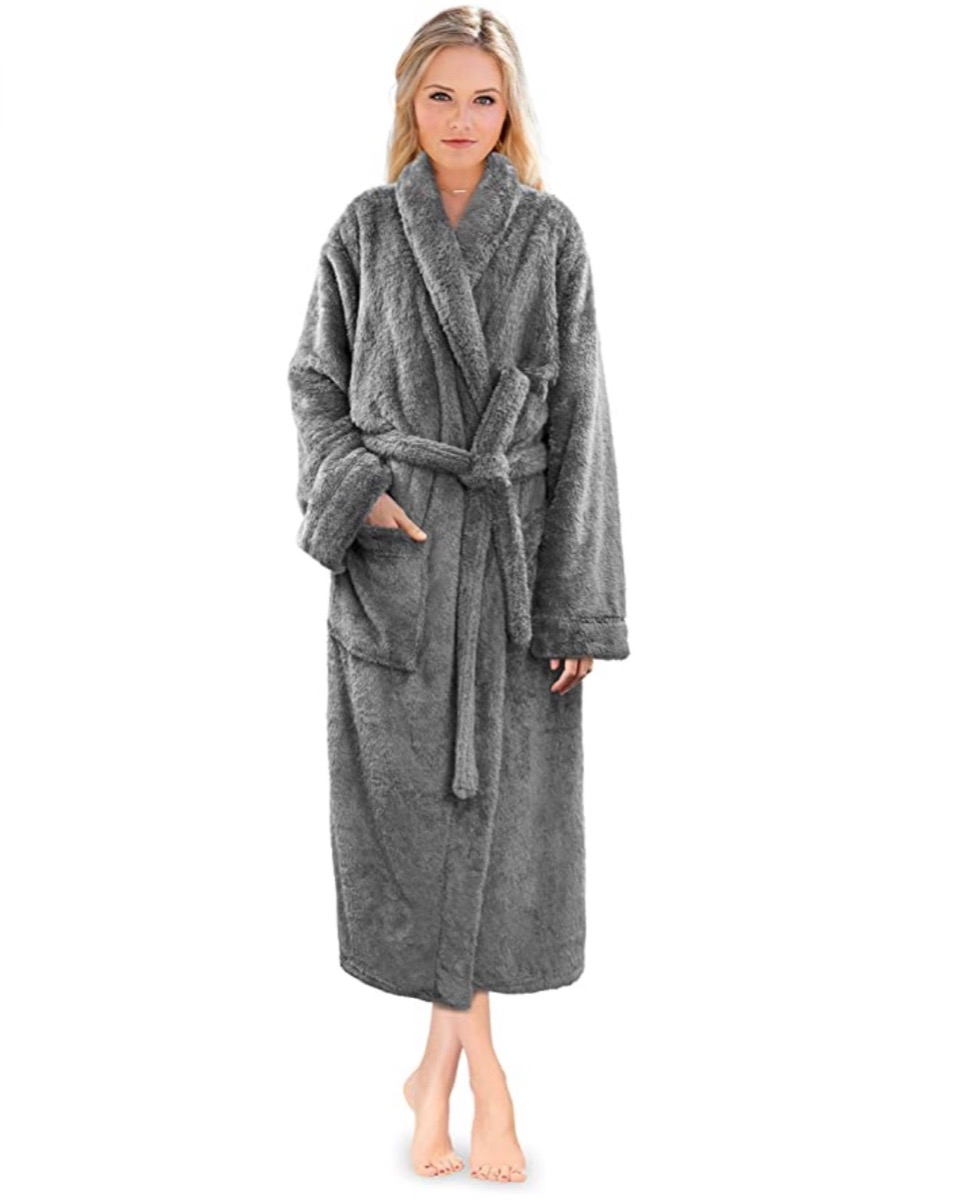 young blonde woman in gray fluffy robe