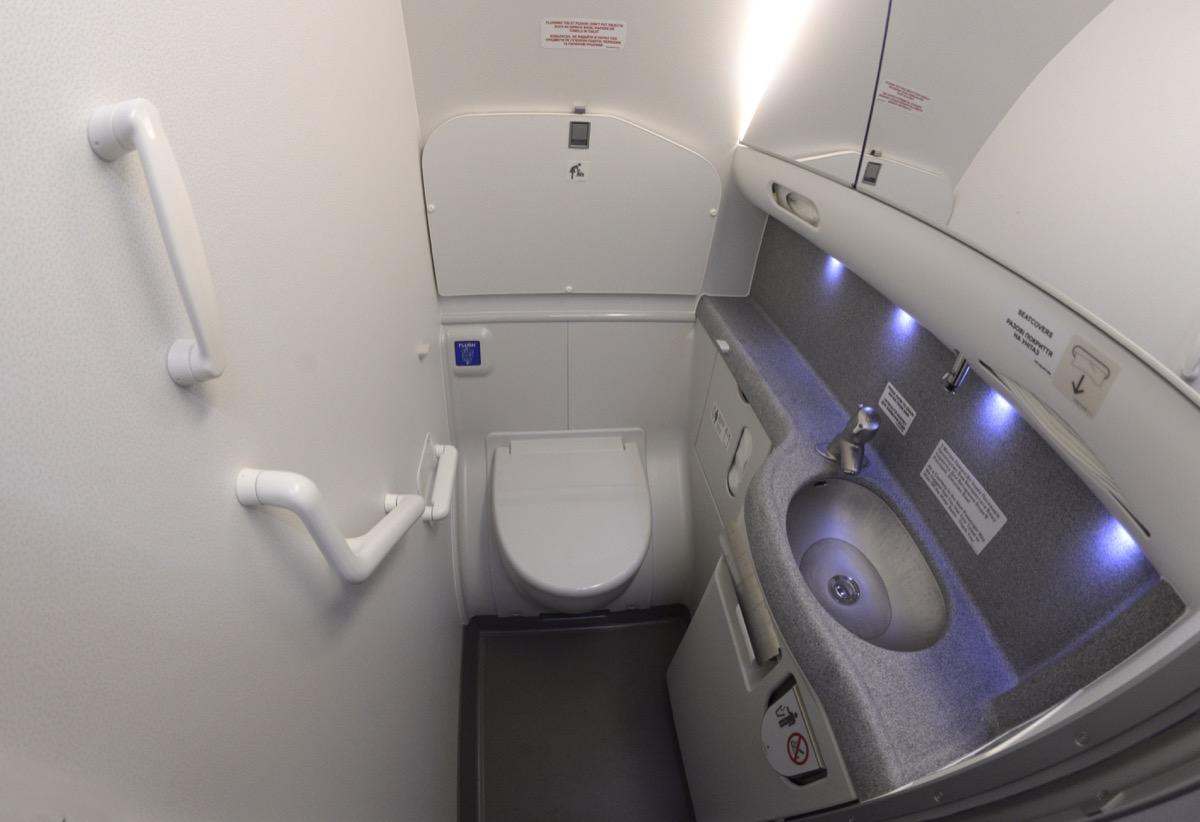 a bathroom in a boeing 737 airplane