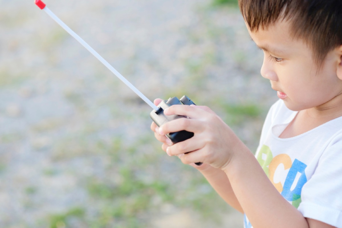 little boy playing with remote control car, things that annoy grandparents