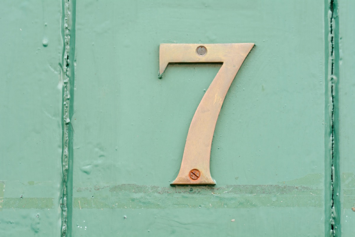 brass number seven on green door, interior design mistakes