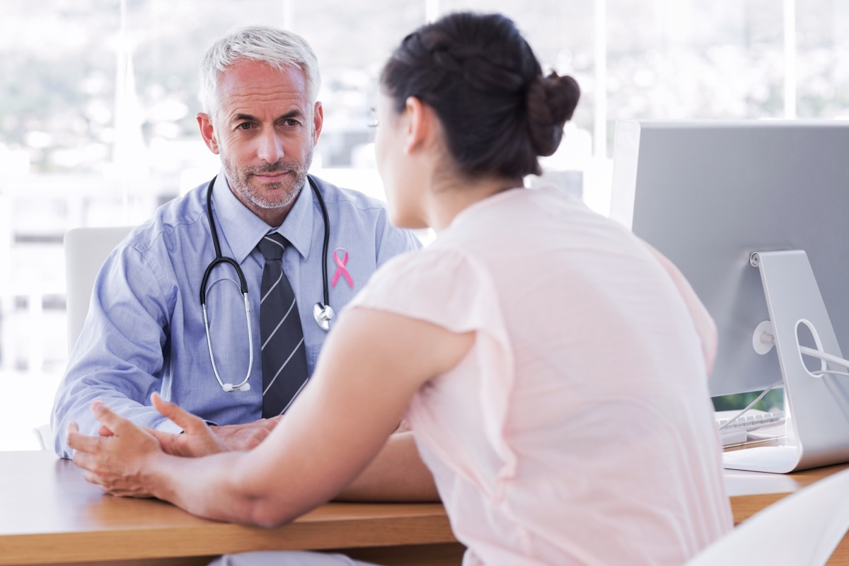 Breast cancer doctor talking to a patient