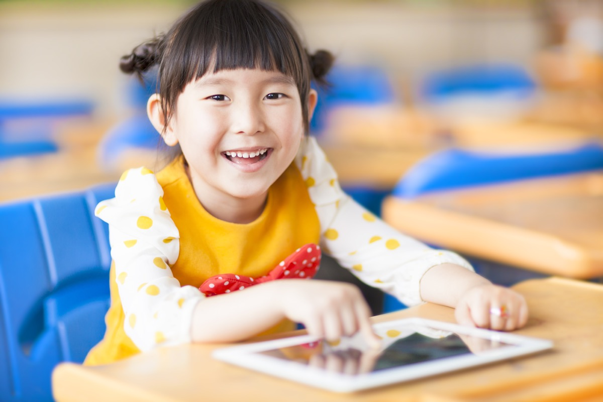 child using ipad at school, worst things about the suburbs