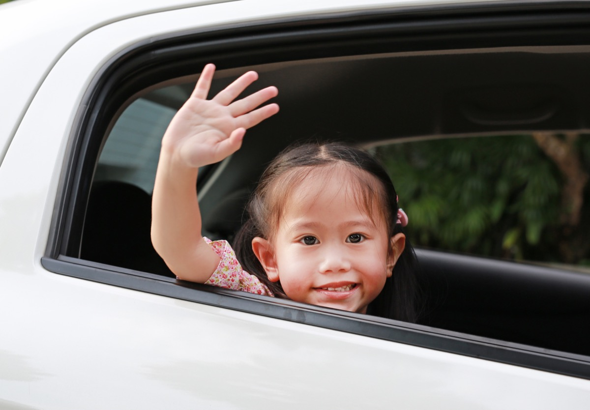 child waving from car old-fashioned manners